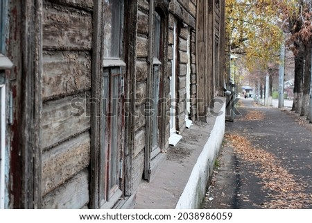 Street in an old city with fallen yellow leaves, autumn . Selective focus. High quality photo Royalty-Free Stock Photo #2038986059