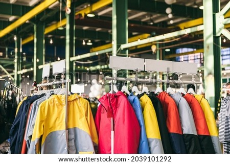 Fashion stylish outerwear display on the local market. Image and stylish services, selection of colors, types. Capsule spring wardrobe Royalty-Free Stock Photo #2039101292