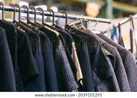 Fashion stylish outerwear display on the local market. Image and stylish services, selection of colors, types. Capsule spring wardrobe Royalty-Free Stock Photo #2039101295