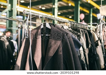 Fashion stylish outerwear display on the local market. Image and stylish services, selection of colors, types. Capsule spring wardrobe Royalty-Free Stock Photo #2039101298