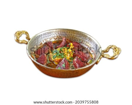 Turkish sausage kangal sucuk in a copper pan. A traditional turkish breakfast on white background. Sujuk (sucuk), a dry spicy sausage. Royalty-Free Stock Photo #2039755808