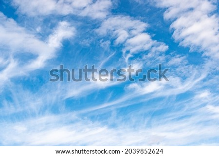 Light layered cirrus clouds. Background with white clouds floating above the ground at flight altitude. Picture for weather forecast. Relax.