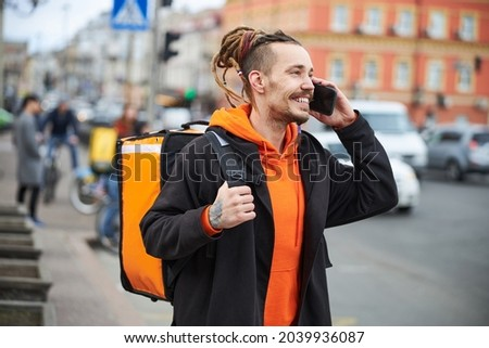 Handsome young courier doing express food transferring