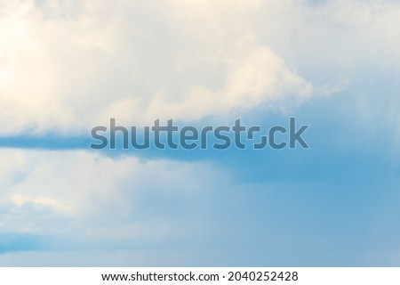 Cumulus clouds before a thunderstorm, storm. Background with white clouds floating above the ground at flight altitude. Picture for weather forecast.