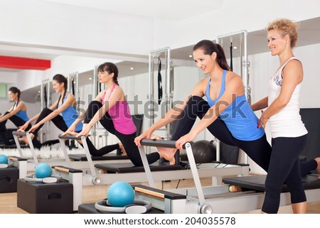 Women training in the gym #204035578