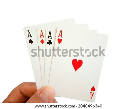A man is holding of four aces cards, isolated on white background Royalty-Free Stock Photo #2040496340