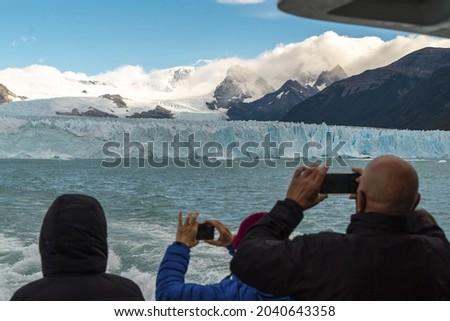 Person from a boat taking a picture of the Perito Moreno glacier