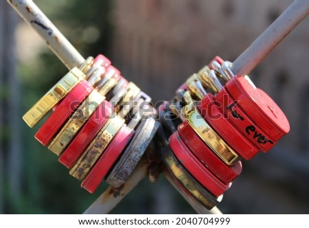 Locks hang on the fence as a symbol of strong love