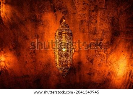 Arabian style lantern with burning candle glowing light ornamental arabic Royalty-Free Stock Photo #2041349945