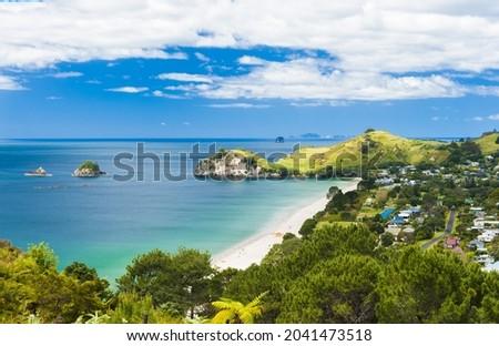 Photo of a beautiful white sand Hahei beach at Cathedral Cove Marine Reserve, Coromandel Peninsula, New Zealand.