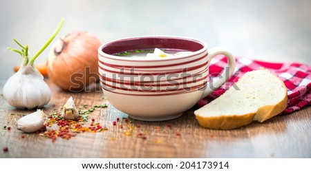 delicious plate of vegetable soup on a wooden table #204173914