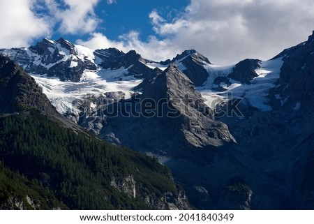 Panorama of a colored mountain landscape in South Tyrol, Italy with the snow covered mountains. High quality photo Royalty-Free Stock Photo #2041840349