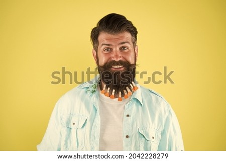 Love grooming. Love myself. Treat beard with love. Valentines day. Barbershop concept. Hairdresser salon. Hairstyle guideline. Man lot clothespin on beard. Brutal hipster with clothespins with hearts Royalty-Free Stock Photo #2042228279