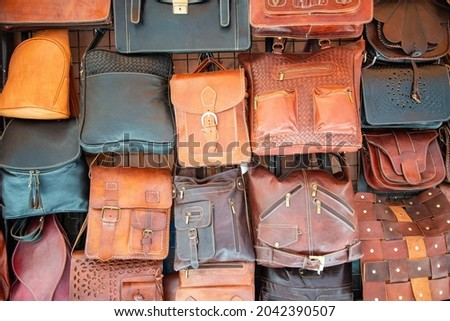 Exhibition of a multitude of leather legs in a traditional shop in Granada, Andalusia, Spain. Royalty-Free Stock Photo #2042390507