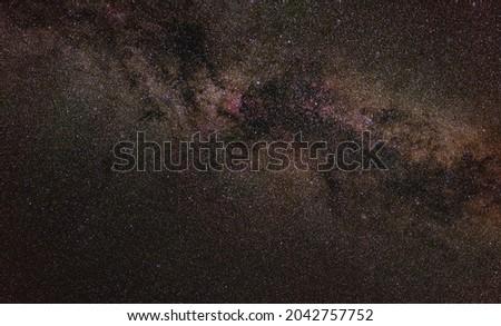 Night sky, many stars with milky way around Cygnus constellation, North America nebula visible. Long exposure stacked photo  Royalty-Free Stock Photo #2042757752