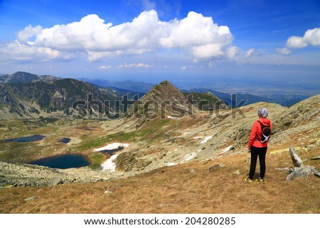 Beautiful landscape with sunny mountains admired by hiker woman #204280285