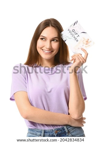 Young woman with gift voucher for massage on white background
