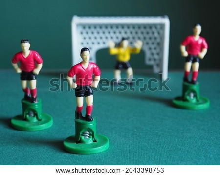 Table football. Soccer table figures, dressed in red. Symbol for teamwork. Game strategy