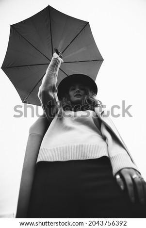 autumn photo shoot a girl and an umbrella, a walk through an autumn field, black and white film fuzzy photo