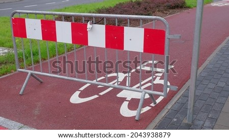 Bike Lane Closed with Metal Red and White Road Barrier Royalty-Free Stock Photo #2043938879
