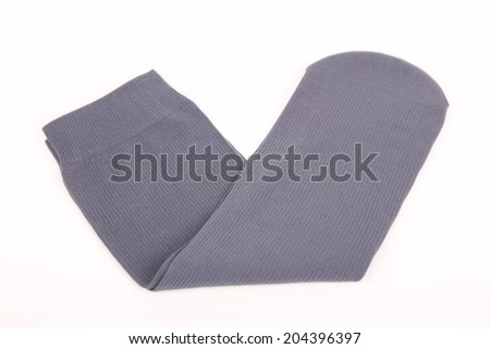 A stack of gray socks isolated on a white  #204396397