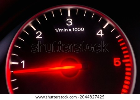 Dashboard with speedometer, tachometer, odometer. Car detailing. Car dashboard. Dashboard details with indication lamps.Car instrument panel.Modern interior.Close up shot.Blurred image. Royalty-Free Stock Photo #2044827425