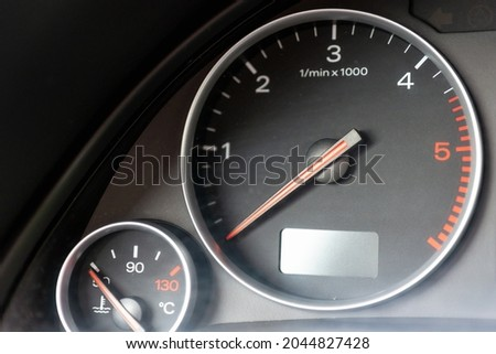 Dashboard with speedometer, tachometer, odometer. Car detailing. Car dashboard. Dashboard details with indication lamps.Car instrument panel.Modern interior.Close up shot. Royalty-Free Stock Photo #2044827428