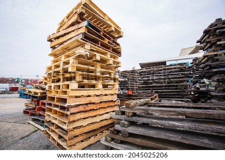 Stock Piles of wooden pallets in a yard ready for breaking up and recycling.