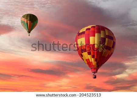 Hot Air Balloons Ascending in a Beautiful Sunset #204523513
