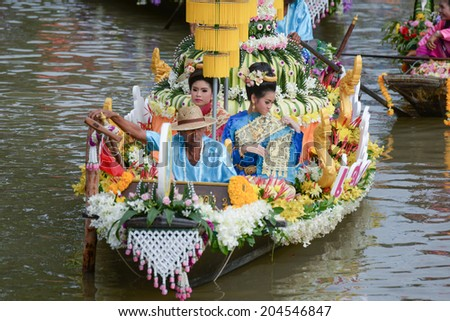 AYUTTHAYA, THAILAND - JULY 11: Beautiful flower boats in floating parade, the unique annual candle festival of Buddhist lent on July 11, 2014  in Ladchado, Ayutthaya, Thailand #204546847