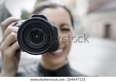 Photographer takes pictures in the open air #204647131