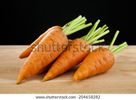 carrot on a black background #204658282