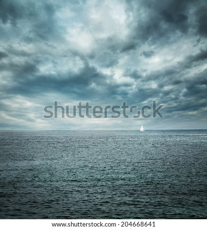 Sailing Boat at Stormy Sea. Dark Background. Loneliness Concept. Toned Photo. Copy Space. #204668641