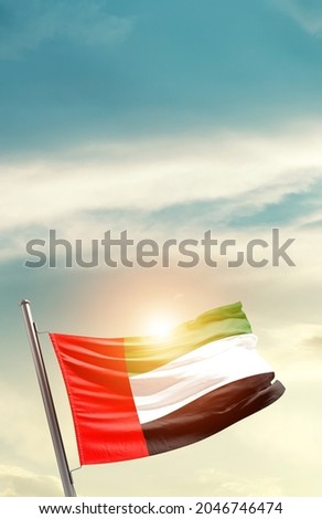 United Arab Emirates national flag waving in beautiful clouds. Royalty-Free Stock Photo #2046746474