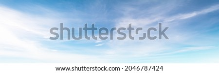 The sky has the light of the sun, the sky is blue, there are small and large clouds alternating and moving slowly, with the sunlight passing, creating a miraculous abstract shape, a hot day. Royalty-Free Stock Photo #2046787424