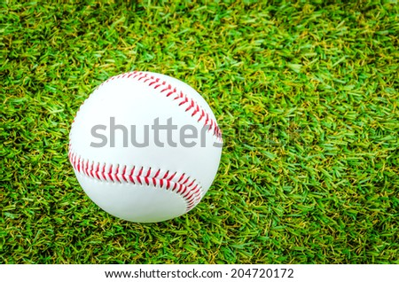 Baseball on green grass
