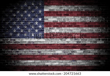 American flag over a grunge brick background.