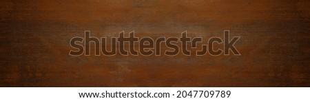 Grunge rusty dark orange brown weathered aged metal corten steel wall texture background banner panorama Royalty-Free Stock Photo #2047709789