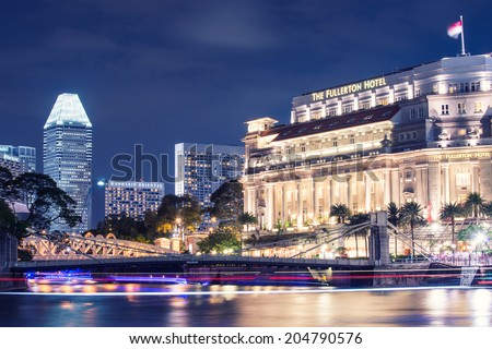 SINGAPORE - May 13 : The Fullerton Hotel Singapore at light on May 13, 2014 in Singapore. It is is a five-star luxury hotel from 2011 and was opened on 27 June 1928. #204790576