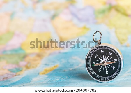 compass on the tourist map. Focus on the compass needle #204807982