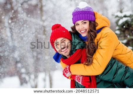 Photo of charming pretty marriage couple wear windbreakers embracing smiling having fun walking snowy weather outside park Royalty-Free Stock Photo #2048512571