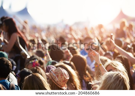 Audience At Outdoor Music Festival Royalty-Free Stock Photo #204860686