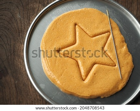 Korean Dalgona or Ppopgi honeycomb candy from Squid Game Royalty-Free Stock Photo #2048708543