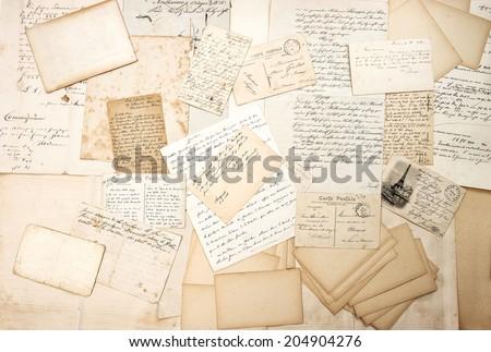old letters, handwritings and vintage postcards. nostalgic sentimental background. ephemera