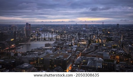 The Thames river and city of London in the evening Royalty-Free Stock Photo #2050308635