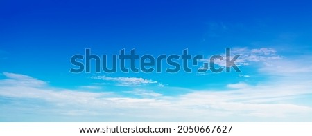 The sky has the light of the sun, the sky is blue, there are small and large clouds alternating and moving slowly, with the sunlight passing, creating a miraculous abstract shape, a hot day. Royalty-Free Stock Photo #2050667627