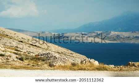 A Scenic beauty, landscape Scene, View of hills and green mountains with blue sky and clouds. High quality photo Royalty-Free Stock Photo #2051112362