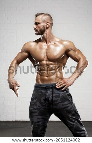 Athlete guy body. Bodybuilding man stock photo. Military trains your muscular body. Rocking man show pumped up muscles. The strong male flex your muscles.  Royalty-Free Stock Photo #2051124002