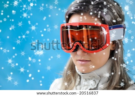 beautiful girl in ski clothes and snowflakes falling #20516837