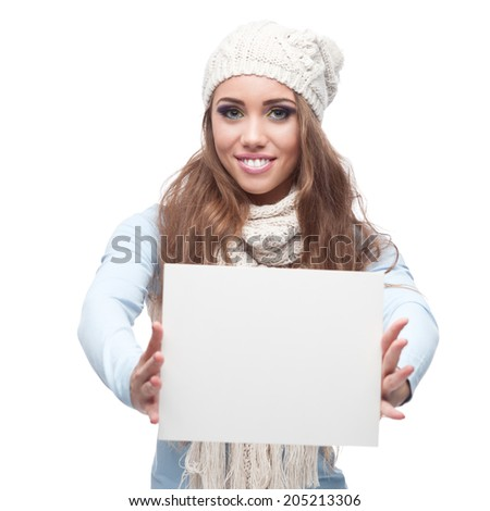 young happy smiling caucasian brunette woman in winter clothing holding sign isolated on white #205213306